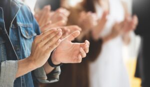 male and female hands clapping for congratulations