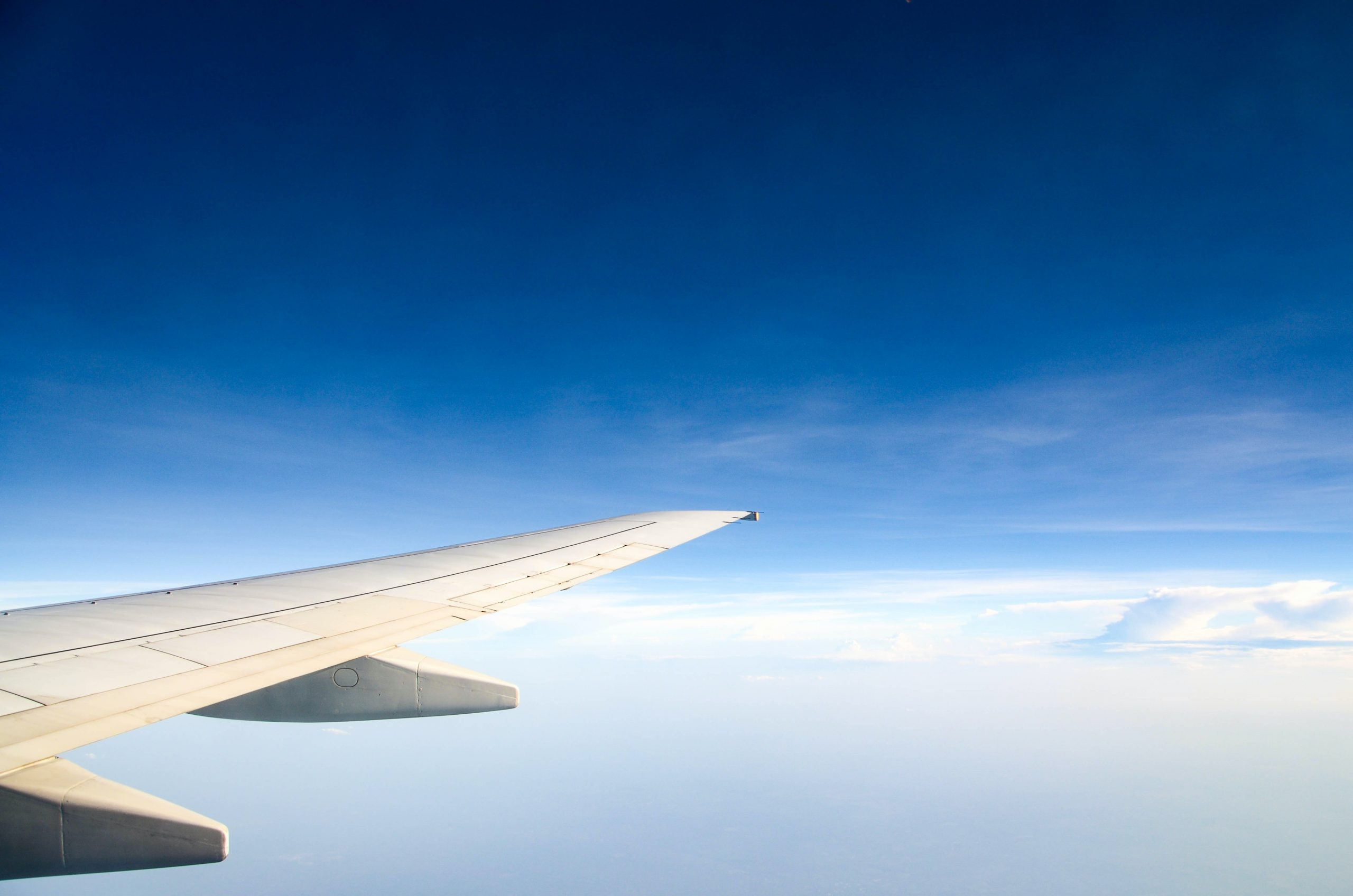 plane wing above clouds