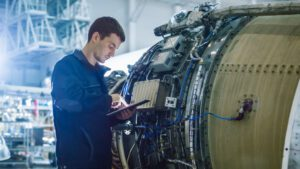 technician on tablet in front of aircraft