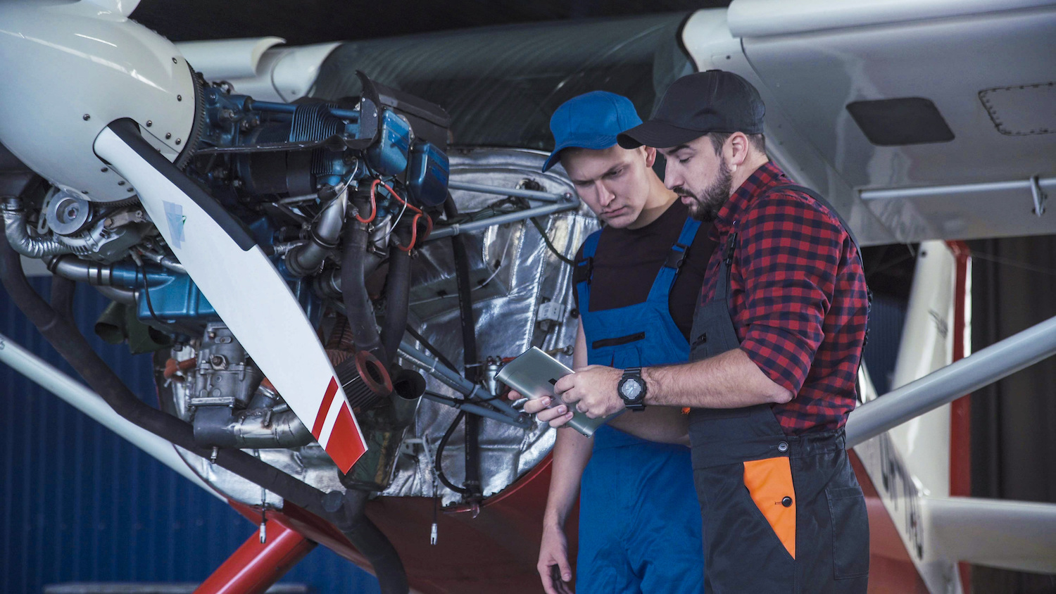 technician talking to another technician about plane troubleshooting