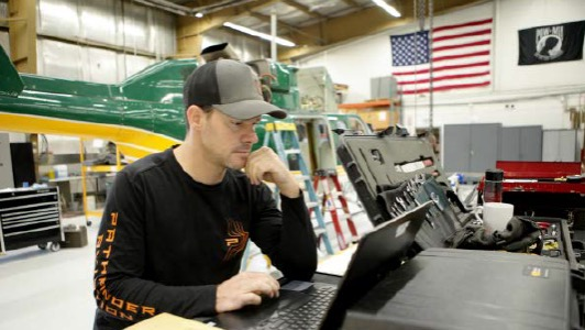 Jesse Kirby Shop Foreman Pathfinder Aviation in Hangar with Helicopter using Flightdocs